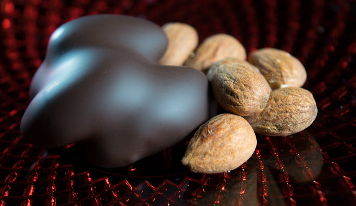 Almonds in dark couverture